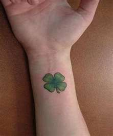 four leaf shamrock wrist tattoo
