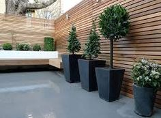 cedar hard wood fencing with slate floor garden - Google Search