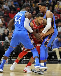 eb173053f Chicago s Denzel Valentine tries to pass against Oklahoma City s Patrick  Patterson
