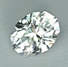 MJ126 - 3.71ct white Zircon - Cambodia 9.90 x 7.50 x 5.85 mm clean, custom cut, remarkable brilliance, photos and video do no justice to this gem! $325 shipped