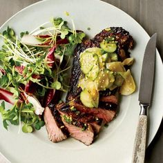 Grilled Steak with Cucumber-and-Daikon Salad | David Myers grills with bincho (hard white charcoal) and serves the steak with yuzu kosho, a condiment of yuzu (a citrus), chiles and salt. Home cooks can use a grill pan or any kind of outdoor grill for strip steaks. The topping: lemon zest, chile, daikon and cucumber salad.