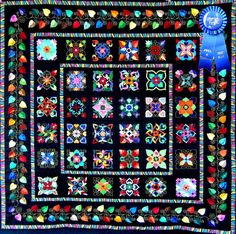 """The Affairs of the Heart Quilt was awarded the First Place Blue Ribbon at the New Mexico Fiber Arts Fiesta, for Traditional Pieced, Appliqued or Mixed Technique Quilts. Based on the design by Aie Rossmann in her book """"Affairs of the Heart"""""""