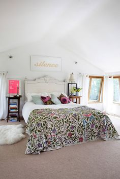 I really like the look of all white with the very colorful bedspread