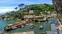 Polperro Harbour in Polperro, Cornwall on the Southwest coast ... I'd like ones of those homes on the hills ~ way back from the surge. via @polperronews