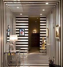 Horizontal/Vertical Black and White stripes. Minimal furniture. Futuristic. Trippy.