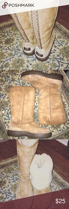 Ugg tall boots Tall- option to roll down. Adorable with anything. Used with normal wear and tear. Please take not to picture of heal above^. Part of plastic came off. Only this problem. UGG Shoes Winter & Rain Boots