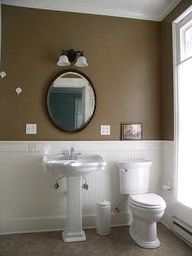 Earthy brown looks great with white fixtures, pedestal sink and white wainscoting give this country bathroom style and flair. Contemporary Bathroom Lighting, Modern Bathroom, Small Bathroom, Half Bathrooms, Downstairs Bathroom, Master Bathroom, Painting Bathroom Walls, Wainscoting Bathroom, Wainscoting Ideas