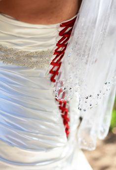 The red stitching on this baseball bride's wedding dress is amazing!  Simple and elegant ...  #baseballwedding