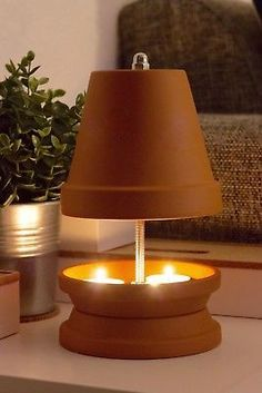 23 Clever DIY Christmas Decoration Ideas By Crafty Panda Fireplace Candle Holder, Candles In Fireplace, Candle Holders, Clay Pot Crafts, Diy And Crafts, Arts And Crafts, Tea Light Candles, Tea Lights, Diy Heater