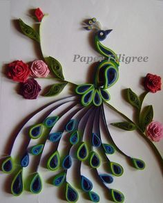 An elegant Paper Quilled Peacock is a picture frame which can be used for interior decoration in any modern houses !