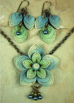 Barbara Fajardo makes the most wonderful polymer clay jewelry. She has a fantastic color sense and her textures are divine.