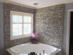 Homeowners from Ardmore, OK, sent in photos of their stunning new bathtub wall surround. Stone is 'in' at the moment. While arguably a good stone. The post Stunning Corner Bathtub Wall Surround appeared first on Mack Makeovers. Stone Bathtub, Bathtub Walls, Bathtub Wall Surround, House, Corner Tub, Remodel, Home Remodeling, Remodeling Mobile Homes, Small Bathroom Remodel