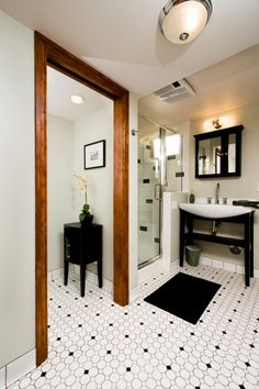 black and white tile bathroom floor and small shower for downstairs bath