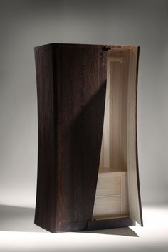"John Lee furniture - ""Mollusc"" - armoire in Fumed Oak with Bleached Ash interior. 2011. Privately commissioned, United Kingdom. H 210cm x W 110cm x D 70cm."