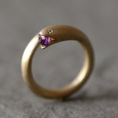 Open mouth snake ring with amethyst from michellechangjewelry on Etsy  I haven't been able to find any snake jewelry that I like since being initiated but I just LOVEE this! ΣΚ<3