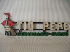 Letrero en madera Retro, ambientada en la zona Puerta de Sol de Madrid.