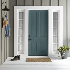 Magnolia's Sir Drake Exterior Paint makes for a welcoming front door. Exterior Gris, Exterior Gray Paint, Exterior Door Colors, Front Door Paint Colors, Painted Front Doors, House Paint Exterior, Paint Colors For Home, Outside House Paint Colors, Gray Exterior Houses