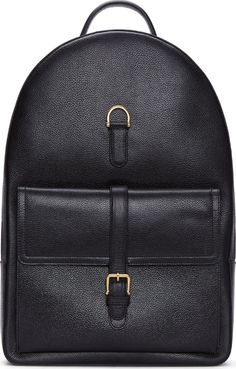 Leather Buckle Backpack in black by Thom Browne. Structured pebbled leather backpack in black. Gold-tone hardware. Adjustable shoulder straps. Grab handle at top. Two-way zip closure at main compartment. Pocket at front with pin-buckle closure. Fully Lined in signature striped pattern. Zip pocket and logo patch at interior.  http://www.zocko.com/z/JK2VV