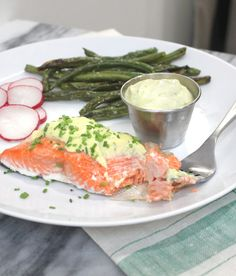This Lemon Herb Aioli tastes amazing on everything, but especially good on Baked Salmon. Made with paleo friendly coconut and avocado oil.