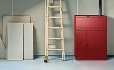 Slim Kantina Heating System Wood Pellet Stoves, Wood Pellets, Heating Systems, Locker Storage, Slim, Home Decor, Decoration Home, Room Decor, Home Interior Design