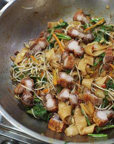Rice noodles with lechon kawali, togue (mung bean sprouts) and kangkong (water spinach)