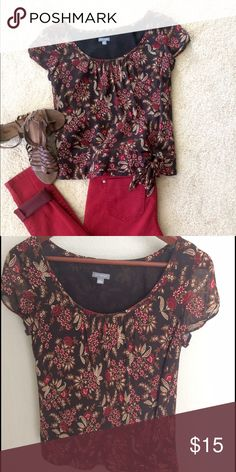Ann Taylor blouse Ann Taylor blouse size 4. Fits blousy but more fired at bottom with small knot.  Can wear with brown, tans or red.  Light weight fabric, outside is silk & lining poly. Ann Taylor Tops Blouses