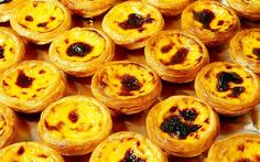 Portuguese egg tart - street food of Macau Dark stuff on top of each tart are burnt sugar...gives the top of the egg in the tart a bit of a crunch.