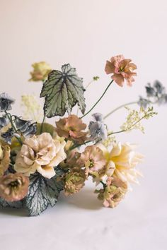 gorgeous neutrals florals color palette. muted colors for autumn and fall weddings. dried roses. maple leaves.