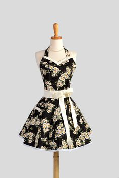 Sweetheart Retro Apron : Sexy Kitchen Apron in Cute and Flirty Handmade Ruffled in Black and White Apple Blossom with Creamy White Trim. $38.00, via Etsy.