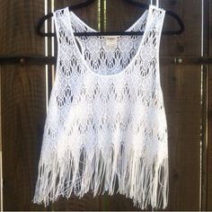 NEW!  Free People Intimately fringe lace cami tank This crop tank is super adorable!  Available in white, this top is super versatile to will pair easily with everything and can be dressed up or down!  Absolutely perfect over swimwear as well & will look incredible with your favorite maxi skirt.  Brand new, never worn.  Size is Medium.  Very stretchy & ultra comfy!  Hard to find piece.  Don't miss this one! Free People Tops Tank Tops