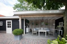 Van Looy Totaalbouw   Veranda's, serres, overkappingen en tuinhuisjes