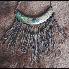 Free People turquoise embedded fringe necklace Big necklace with chain fringe and turquoise stone. Cute, but too big for my liking. Worn like once. Free People Jewelry Necklaces