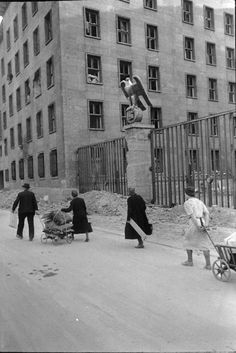Berlin 1945 refugees trudge past Göring's Luftwaffe Air Ministry on the Wilhelmstraße