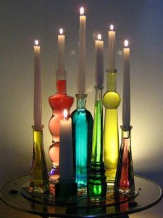 Make an unusual centerpiece using bottles, filled with tinted water. Insert a taper candle into each one. These bottle taper candle holders dazzle, especially when lit from the back. Bottle Candles, Bottles And Jars, Glass Bottles, Wine Glass, Diy Bottle, Bottle Art, Bottle Crafts, Plastic Bottle, Candle Lanterns
