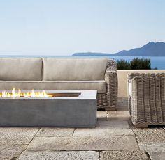 Restoration Hardware natural gas firepit in weathered slate. (for the front sitting area?)