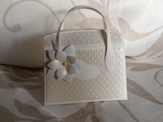 Handmade handbag made using Ventura pearl card stock, Dreamees flower polymer stamp and tonic Kensington handbag dies