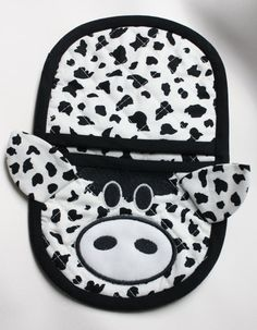 In the hoop cow oven mitt   https://www.etsy.com/listing/170949595/in-the-hoop-cow-oven-mitt-pot-holder-for