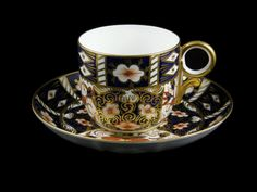 Royal Crown Derby Cup and Saucer (1906)   Pattern 2451 named 'Traditional Imari' was introduced in 1887 and is based on the earlier pattern number 877 from the year 1880. Pattern 2451 is one of the 'B Group' of patterns with a distinctive border around the design (seen around the rim of the cup).