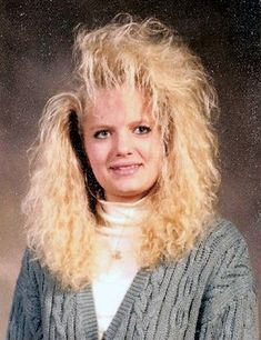 Fried, permed, big hair with rooster bangs.  Aqua net was my best friend. Sickie.  I don't know who this chick is...but we had the same hair style. :/