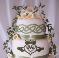 Irish wedding cake. I like the ribbon idea and the knots on the top layer