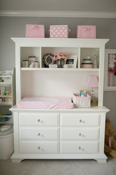 Dresser and hutch converted to a diaper changing table.