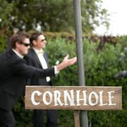Yeah! Corn hole at either the rehearsal dinner or reception! An alternative for those party poopers who don't want to dance.