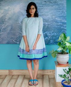 This boho swing dress is crafted from cotton fabric printed with floral motifs in pastel mint blue. The dress features a thick hand block printed border in Frock Fashion, Fashion Outfits, Fashion Advice, Fashion Clothes, Fall Outfits, Summer Outfits, Women's Fashion, Kurta Designs Women, Blouse Designs