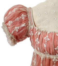 "Town dress owned by Empress Josephine, First Empire. From the Chateau de Malmaision Costume Collection:   ""This high-waisted dress with its square, low-cut neckline and decorated with white embroidered flowers and leaves is typical of the fashion at the start of the First Empire. To conceal the low neckline, it could be worn with a chemisette which was slipped inside the dress. This one is in white muslin embellished with a ruché trim. Poyard who looked after the Empress's wardrobe after…"