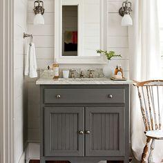 gray vanity + plank wall + sconces