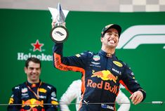 Daniel Ricciardo Photos - Race winner Daniel Ricciardo of Australia and Red Bull Racing celebrates on the podium during the Formula One Grand Prix of China at Shanghai International Circuit on April 15, 2018 in Shanghai, China. - F1 Grand Prix Of China