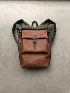ab78404e85312 Leather backpack with waxed canvas roll to close top and leather front  pocket
