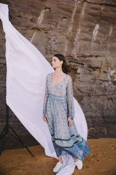 Sweet chiffon dress with beautiful border print. Full length sleeve. Drawstring at waist for a flattering fit. Made by french label BLUE Sold as 'one size' due