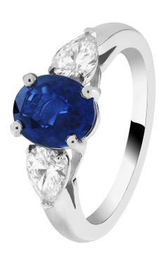 Van Cleef & Arpels Motifs Pétales Solitaire in platinum, set with pear-shaped diamonds and a 2.03ct oval-cut sapphire.