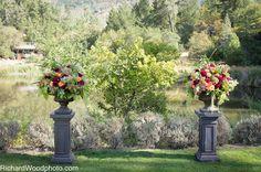 Calistoga Ranch wedding ceremony flowers on Lommel Lawn.  Photo: Richard Wood  Fleurs de France  www.fleursfrance.com